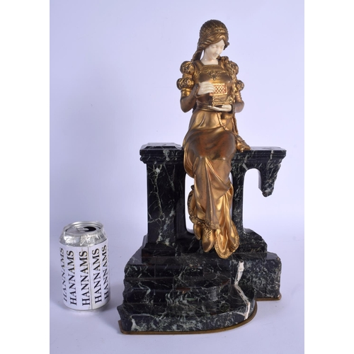 677 - French School (C1900) Gilt bronze and ivory, female viewing into her jewellery box. 40 cm x 22 cm....