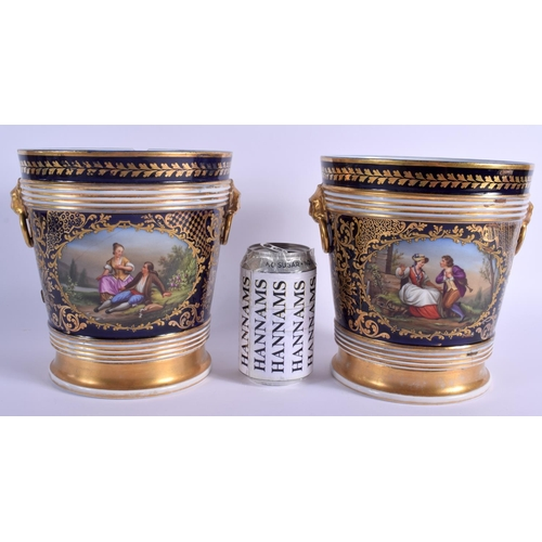 68 - A LARGE PAIR OF 19TH CENTURY FRENCH PORCELAIN CACHE POTS painted with romantic scenes upon a rich bl...