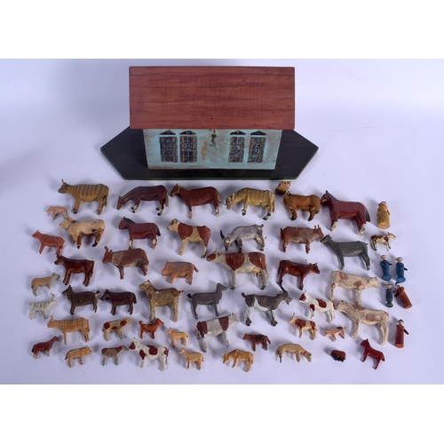 680 - A PAINTED WOOD FOLK ART NOAH'S ARK with animals. Ark 35 cm x 22 cm. (qty)...