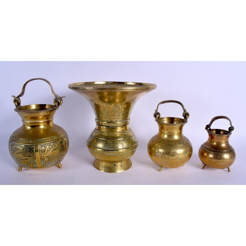 687 - FOUR MIDDLE EASTERN BRASS VASES. Largest 21 cm high. (4)...