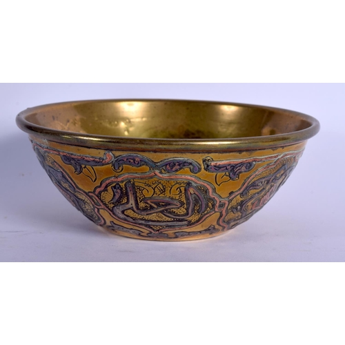 688 - A MIDDLE EASTERN CAIRO WARE SILVER INLAID BRASS DISH together with a similar bowl. Largest 30 cm dia...