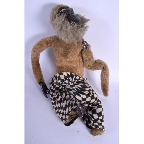 690 - AN UNUSUAL EARLY AUTOMATON ARTICULATED MONKEY. 60 cm long....