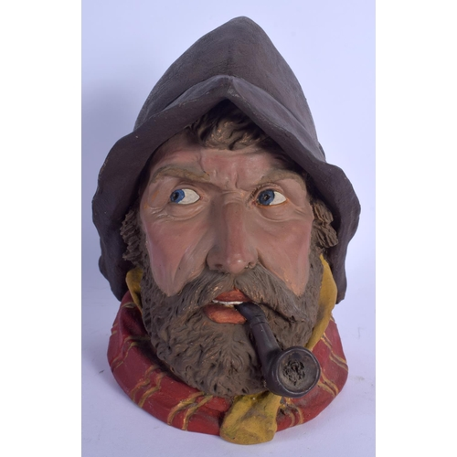 699 - AN ANTIQUE AUSTRIAN TOBACCO JAR AND COVER in the form of a smoking fisherman. 21 cm high....
