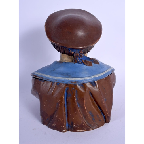 710 - AN ANTIQUE AUSTRIAN TOBACCO JAR AND COVER in the form of a cross armed sailor. 24 cm high....