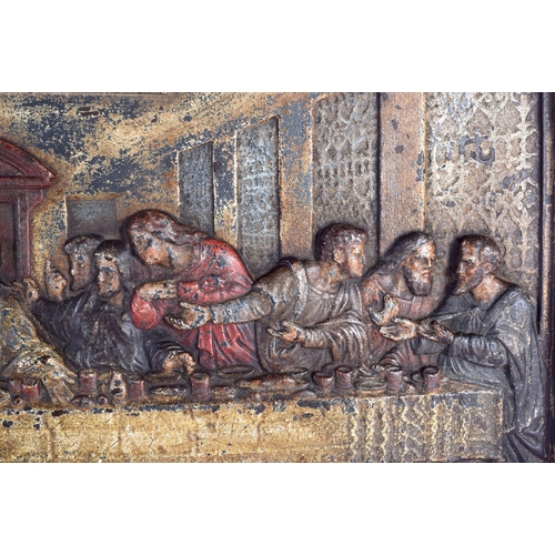 712 - A RARE 19TH CENTURY CONTINENTAL CAST IRON PANEL depicting the last supper. 65 cm x 37 cm....