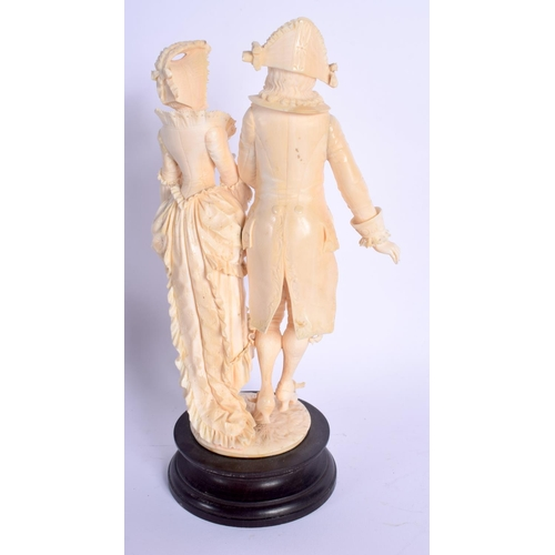 724 - A FINE 19TH CENTURY EUROPEAN DIEPPE IVORY FIGURE OF A DANDY modelled with a female, upon a wooden pl...