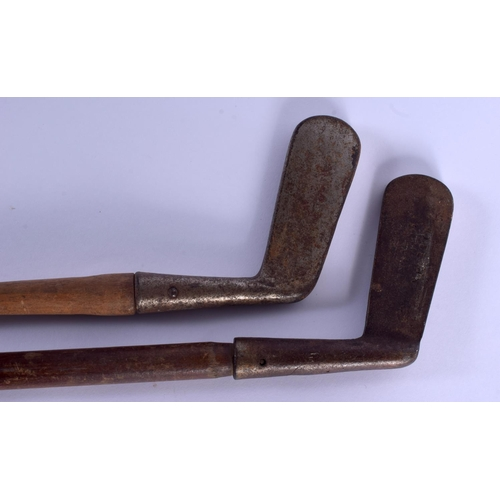 733 - TWO VINTAGE GOLF CLUBS. 85 cm long. (2)...