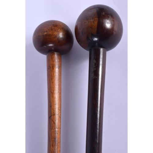 735 - TWO TRIBAL HARDWOOD CLUBS. 71 cm long. (2)...