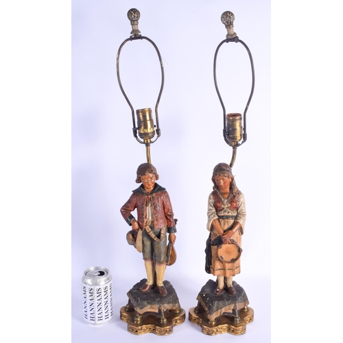 753 - A PAIR OF 19TH CENTURY AUSTRIAN TERRACOTTA FIGURES converted to lamps. Figure 33 cm high....