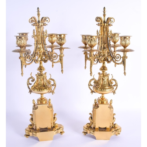 755 - A PAIR OF 19TH CENTURY FRENCH BRONZE CANDLESTICKS formed with paw feet and acanthus. 43 cm x 15 cm....
