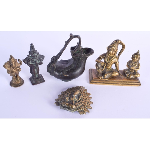 760 - AN EARLY INDIAN BRONZE EWER together with other Hindu bronzes. Largest 9 cm x 11 cm. (5)...