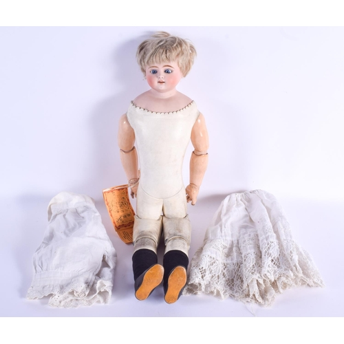 774 - AN ANTIQUE ERNST HEUBACH BISQUE HEADED DOLL with dress. 53 cm long....