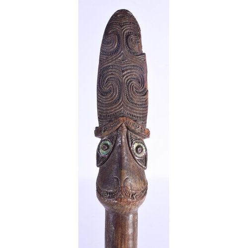 801 - A LARGE MAORI CARVED WOOD STAFF Taiaha, with shell inset eyes and carved zig zag spiralised motifs. ...