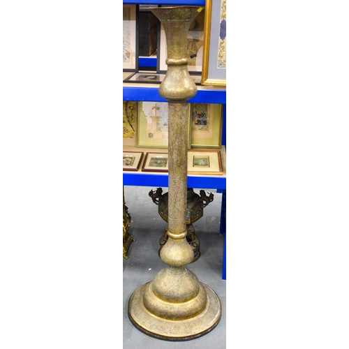 813 - A VERY LARGE 19TH CENTURY ISLAMIC BRASS STANDING FLOOR LAMP inscribed with Kufic script. 160 cm high...