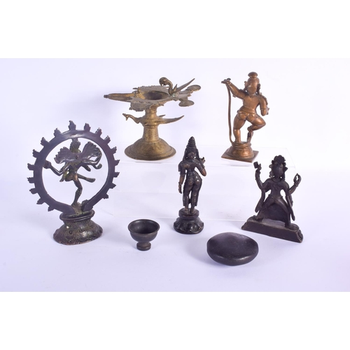 815 - AN 18TH CENTURY INDIAN HINDU BRONZE together with other figures etc. Largest 18 cm x 14 cm. (8)...