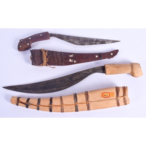 816 - TWO CONTINENTAL WOOD CASED KNIVES. 40 cm long. (2)...