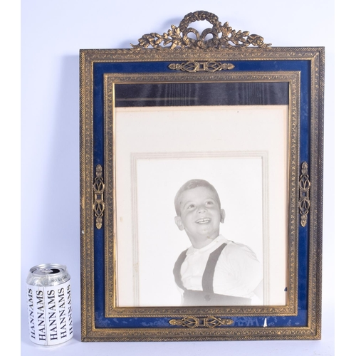 823 - A LARGE NEO CLASSICAL BRASS PHOTOGRAPH FRAME. 45 cm x 37 cm....