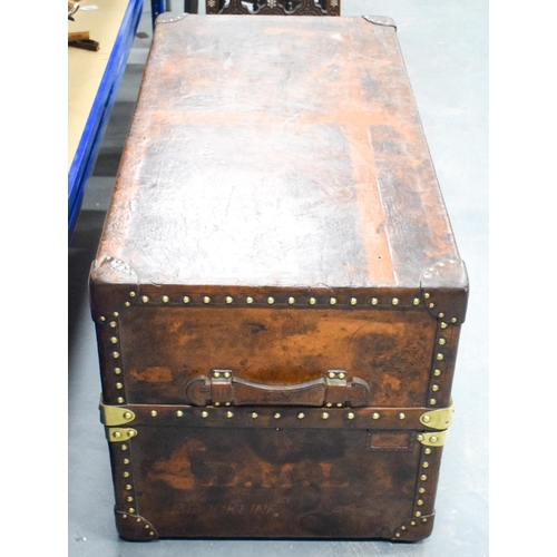 838 - A FINE LARGE LOUIS VUITTON BROWN LEATHER TRUNK with bold brass mounts and locks. 110 cm x 56 cm x 56...
