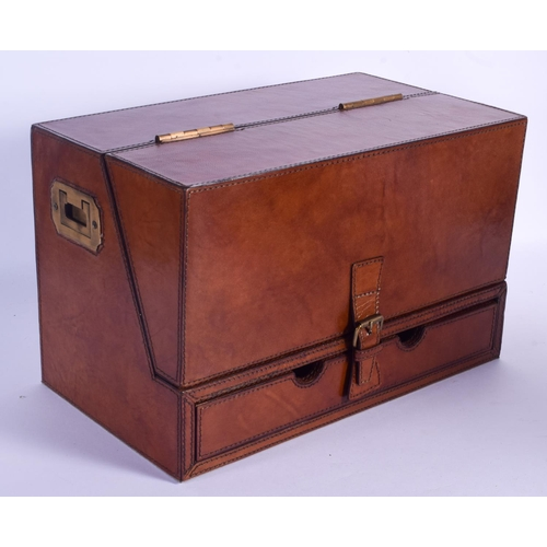 846 - A EUROPEAN LEATHER STATIONARY BOX with brass handles. 38 cm x 20 cm....