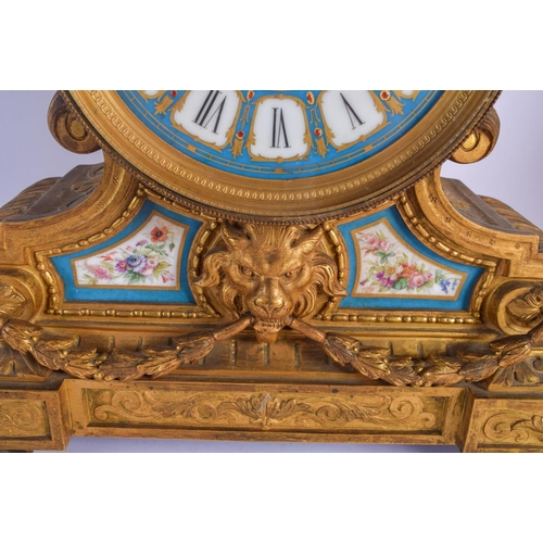 856 - AN UNUSUAL 19TH CENTURY FRENCH GILT BRONZE SEVRES PORCELAIN MANTEL CLOCK with lion mask head mounts....