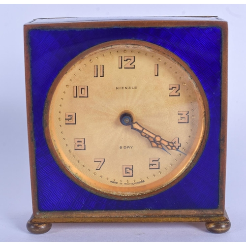 859 - AN ART DECO GERMAN ENAMELLED EIGHT DAY DESK CLOCK. 8 cm x 6 cm....