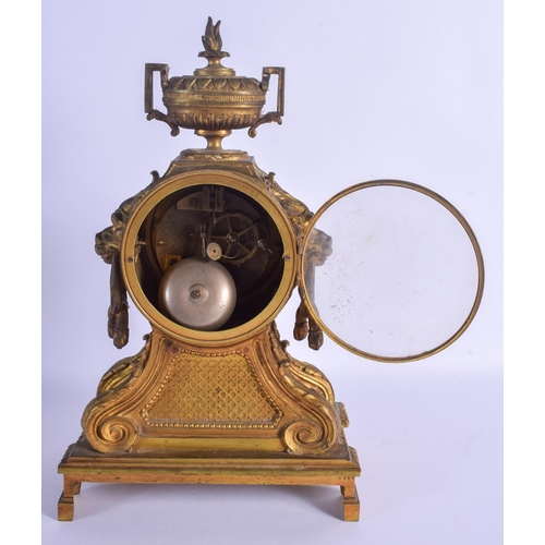 863 - A LARGE 19TH CENTURY FRENCH BRONZE MANTEL CLOCK with bold lion mask head handles, overlaid in acanth...
