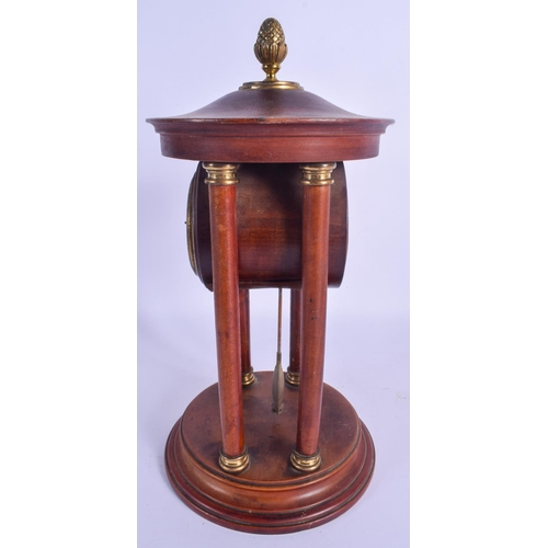 864 - AN ANTIQUE MAHOGANY MANTEL CLOCK of architectural form, with visible pendulum. 30 cm x 12 cm....