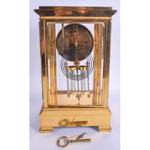 866 - A 19TH CENTURY FRENCH BRONZE FOUR GLASS REGULATOR MANTEL CLOCK with column supports and circular dia...