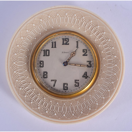 868 - AN EARLY 20TH CENTURY FRENCH EIGHT DAY CARVED IVORY TRAVELLING CLOCK with foliate decoration. 11 cm ...