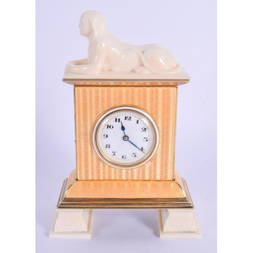 869 - A RARE EARLY 20TH CENTURY EUROPEAN SILVER GILT AND IVORY ENAMEL SPHINX CLOCK upon ivory feet. 12 cm ...