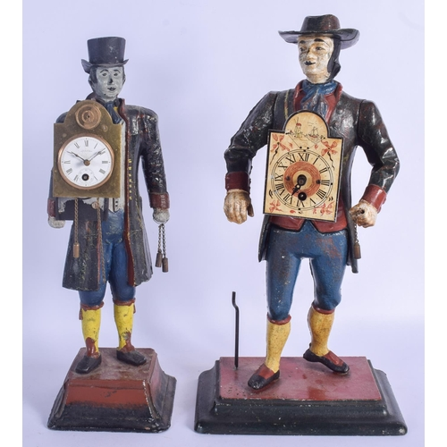 870 - TWO AMERICAN PAINTED CAST IRON FIGURAL CLOCKS each modelled holding clock weights. Largest 40 cm hig...