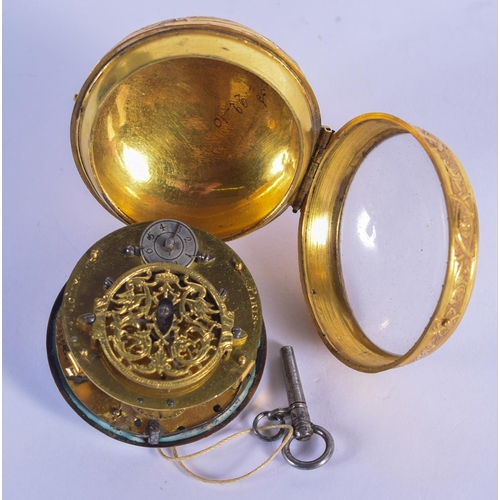 879 - AN 18TH CENTURY FRENCH GILT METAL ONION POCKET WATCH. 152 grams overall. 5.5 cm wide....