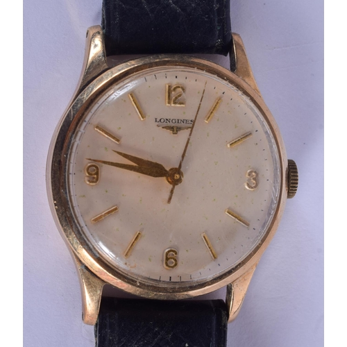881 - A BOXED 9CT GOLD LONGINES WRISTWATCH. 3.25 cm wide....