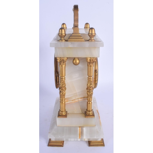 933 - AN ANTIQUE MARBLE AND BRONZE MANTEL CLOCK with column supports. 25 cm high inc handle....