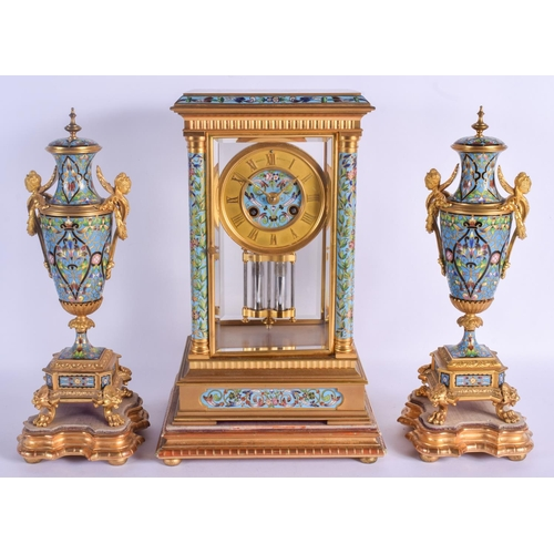 943 - A LARGE 19TH CENTURY FRENCH CHAMPLEVE ENAMEL AND BRONZE CLOCK GARNITURE modelled embellished in foli...
