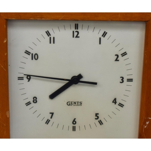 950 - TWO LARGE VINTAGE ELECTRIC CLOCKS one wood cased, the other tin cased. Largest 128 cm x 28 cm. (2)...