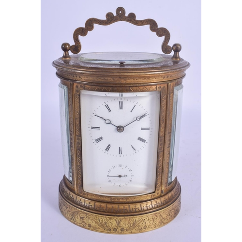 954 - A 19TH CENTURY FRENCH REPEATING ALARM CARRIAGE CLOCK of oval form, engraved with foliage and vines. ...