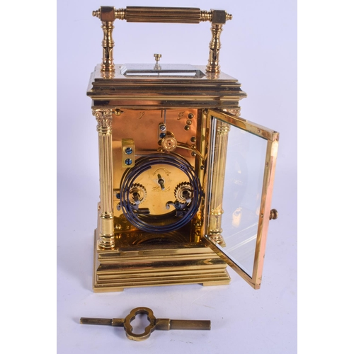 955 - A 19TH CENTURY FRENCH REPEATING CARRIAGE CLOCK of square form, with column supports. 19 cm high inc ...