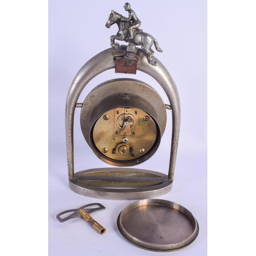 957 - A RARE EDWARDIAN SILVERED BRONZE EQUESTRIAN HORSE RIDING CLOCK formed as a horse shoe. 27 cm x 14 cm...