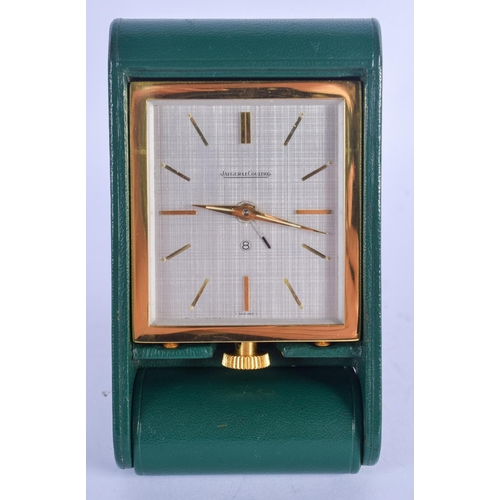 962 - A RETRO JAEGER LE COULTRE LEATHER CASED TRAVELLING CLOCK. 5.5 cm square....