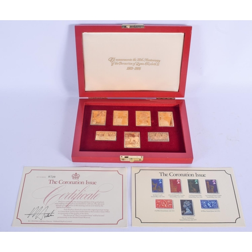 996 - A SET OF CORONATION ISSUE GOLD PLATED SILVER STAMPS. (7)...