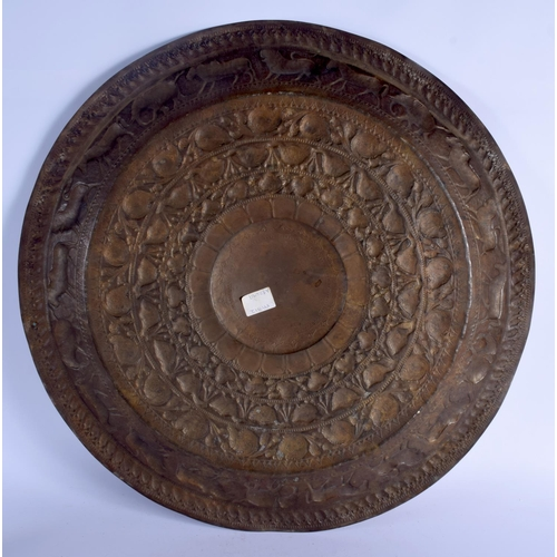 396 - A LARGE 19TH CENTURY INDIAN SRI LANKAN BRASS DISH decorated with animals. 55 cm diameter....