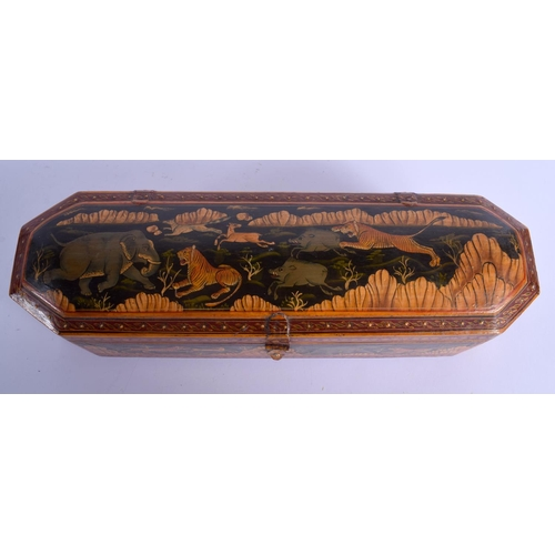 397 - AN UNUSUAL INDIAN PERSIAN WOODEN PAINTED PEN BOX. 30 cm wide....