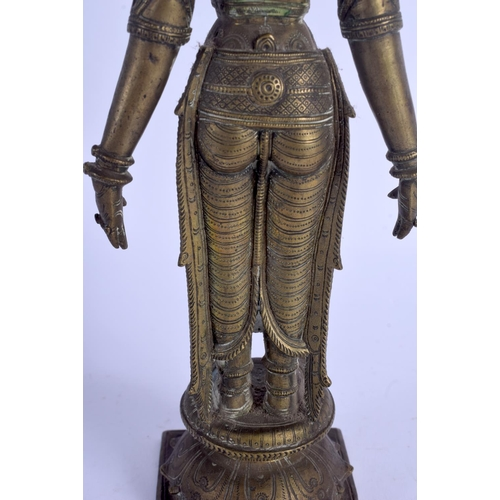 398 - A FINE 18TH CENTURY INDIAN BRONZE FIGURE OF A BUDDHISTIC DEITY well modelled standing upon a square ...