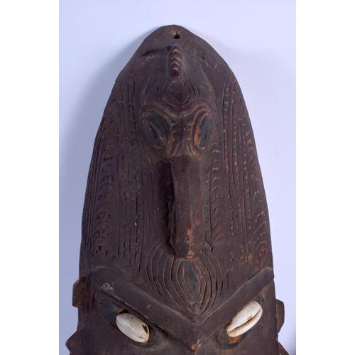 416 - TWO PAPUA NEW GUINEA TRIBAL MASKS. Largest 47 cm x 16 cm. (2)...