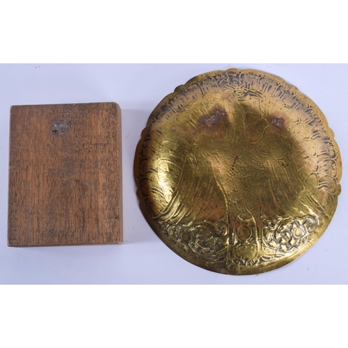 427 - AN EARLY 20TH CENTURY INDIAN BRASS DISH together with an early icon plaque. Largest 12.5 cm wide. (2...