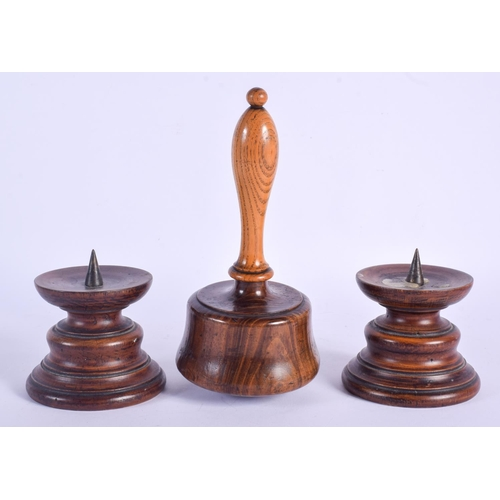 432 - A PAIR OF ANTIQUE TREEN PRICKET CANDLESTICKS and a mallet. Largest 18 cm high. (3)...