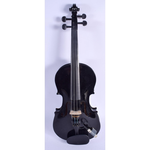 478 - AN ELECTRIC VIOLIN with two bows. 57 cm long. (3)...