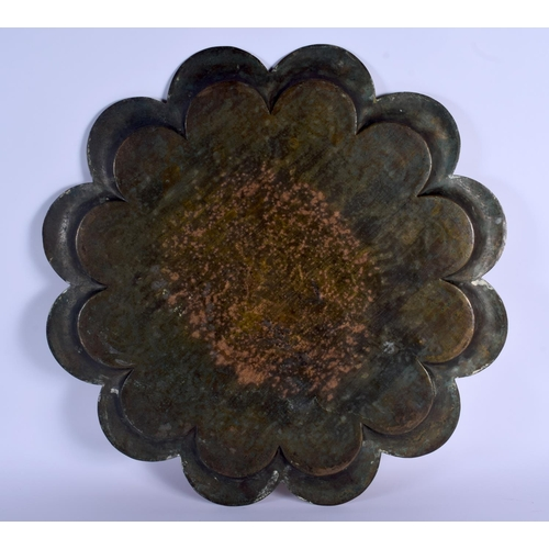 621 - A LARGE MIDDLE EASTERN ISLAMIC BRASS PETAL FORM TRAY engraved with figures and motifs. 50 cm wide....