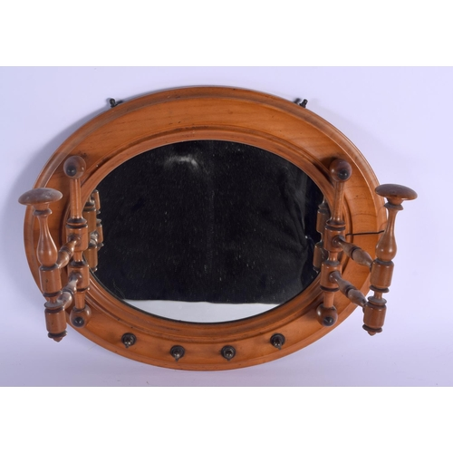 632 - AN EDWARDIAN AESTHETIC STYLE MIRROR COAT HANGING. 35 cm wide....